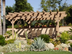 Professional landscaping surrounds an arbor in Camarillo