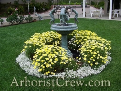 A bird fountain is enhanced by flowers in this beautifully maintained Camarillo yard.
