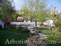 Professionally landscaped home in Camarillo features a fieldstone walkway.
